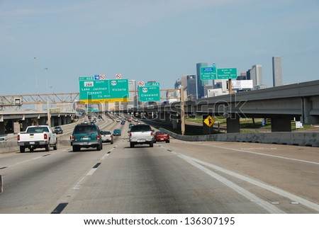 HOUSTON, TEXAS - MAR 24: Cars go to city center, March 24, 2008 in Houston, Texas. Almost 40% of households in Houston has access to two or more motor vehicles