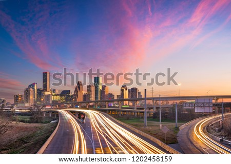 Houston, Texas, USA downtown skyline over the highways at dusk.