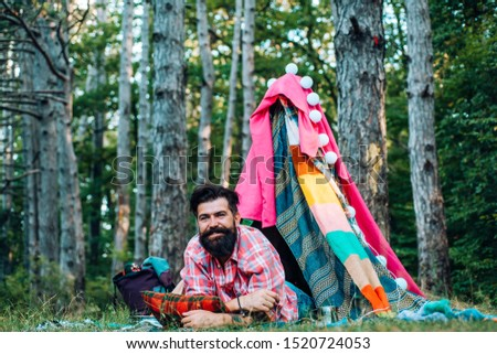 Hovel decorated party. Bearded man in hovel on sky background. Adventure travel. Shelter of branches #1520724053