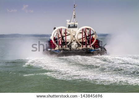 Hovercraft traveling away across sea
