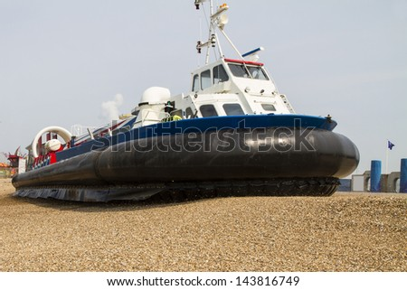 Hovercraft turning for departure on a beach, Southsea, UK