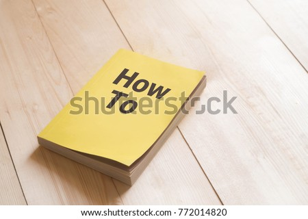 How to book or guidebook on wooden table