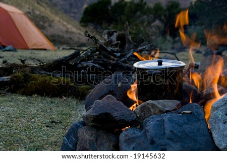 how to cook at an outdoor campsite - stock photo