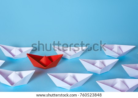 How to find the right employee in the team. White paper boats and from the midst of them stood a red. Copy space for text