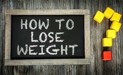 How To Lose Weight? written on chalkboard
