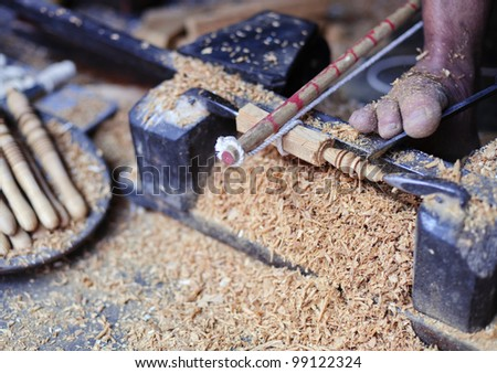 How to make a ring on a stick with a truly manual lathe the Marrakesh way. Observe foot operating chisel,