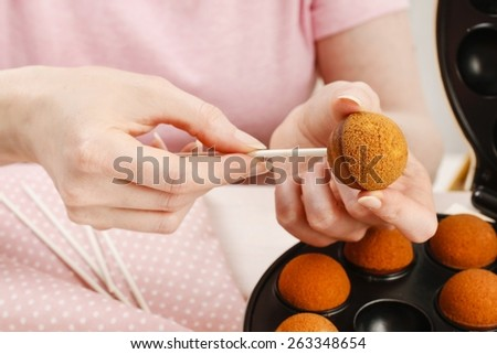 How to make cake pops, step by step, tutorial. Woman making cake pops.