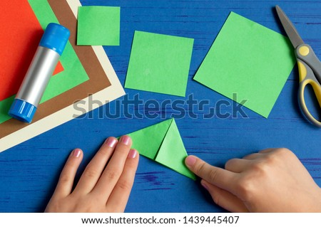 How to make Christmas card with Christmas tree. Original children's art project. DIY concept. Step-by-step photo instructions. Step 4. Fold corners towards each other  #1439445407
