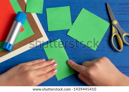 How to make Christmas card with Christmas tree. Original children's art project. DIY concept. Step-by-step photo instructions. Step 3. Fold square in half #1439445410