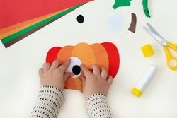 How to make funny pumpkin of color paper. Original project for children. Step-by-step photo instructions. Childrens crafts for the Halloween. Step 4