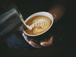 how to make latte art by barista focus in milk and coffee in vintage color