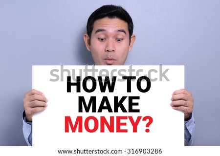 HOW TO MAKE MONEY ? message on white cardboard held by a man with excited face