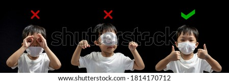 How to wearing medical face mask correctly from asian little boy , how to wearing face mask correct and the wrong , Coronavirus prevention (COVID-19) concept Foto stock ©