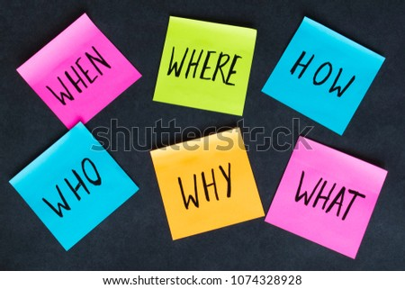 How, why, what, who, where, when questions written on colorful notes on the dark background.