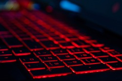 HP omen keyboard with red back lit keys with a shallow depth of field