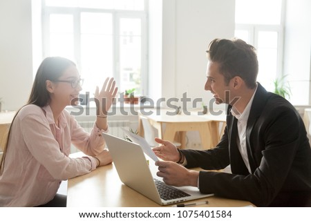 Hr and applicant laughing during successful job interview, happy vacancy candidate talking to smiling recruiter discussing winning resume making good first impression, recruitment and hiring concept