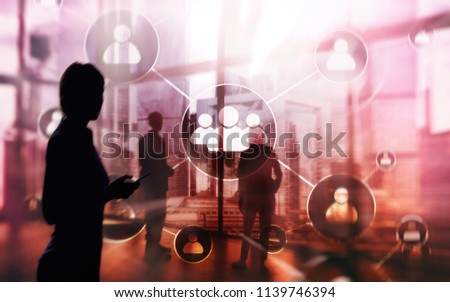 HR - Human resources management concept on blurred business center background. Businessmen by the window.