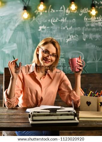 hr management. modern hr woman in glasses working in school office. secretary writes resume for hr job