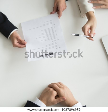 Hr managers reading applicants resume at job interview, recruiters or employers holding cv of vacancy candidate, employment and hiring negotiations, staff recruiting concept, top close up hands view