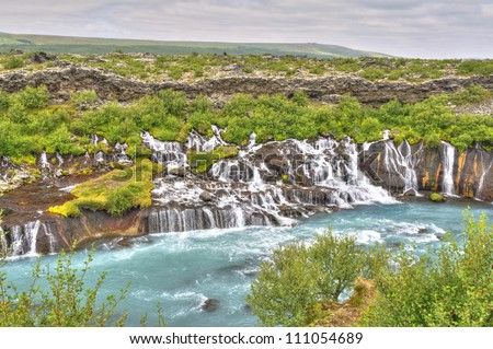 Hraunfossar Waterfall, Iceland - This waterfalls is formed by rivulets streaming over a distance of about 900 meters out of the Hallmundarhraun, a lava field which flowed from a volcanic eruption.