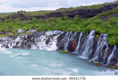 Hraunfossar (Western Iceland) is a series of waterfalls formed by rivulets streaming over a distance of about 900 meters out of the Hallmundarhraun,Iceland