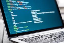 HTML Code on laptop screen. Web Design Concept.