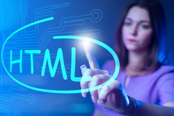 HTML code. Woman drew HTML logo on virtual screen. Website developer HTML5. Website development. Work website developer. Girl programmer web application. Programmer career. HyperText Markup Language