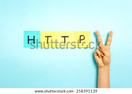 HTTP 2. Hand making V sign gesture, success symbol, on blue background. Stock fotó ©