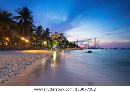 Hua Hin beach at twilight with cloudy sky