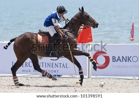 HUA HIN, THAILAND - APRIL 7: An unidentified player of China Polo Team in action during 2012 Beach Polo Asia Championship on April 7 2012 in Hua Hin Thailand. China Polo Team loses to Thai team 6-4.