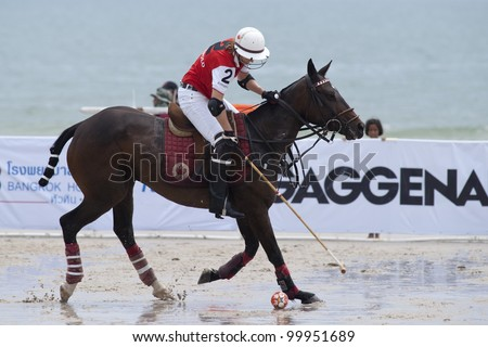 HUA HIN, THAILAND - APRIL 7: C. Zeisberger of India Polo Team in action during the 2012 Beach Polo Asia Championship on April 7, 2012 in Hua Hin, Thailand. India Polo Team wins 6-2.