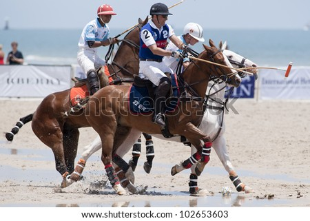 HUA HIN, THAILAND - APRIL 7: China Polo Team (navy blue) & Thai Polo Team (blue) in action during 2012 Beach Polo Asia Championship on April 7, 2012 in Hua Hin, Thailand. Thai Polo Team wins 6-4.