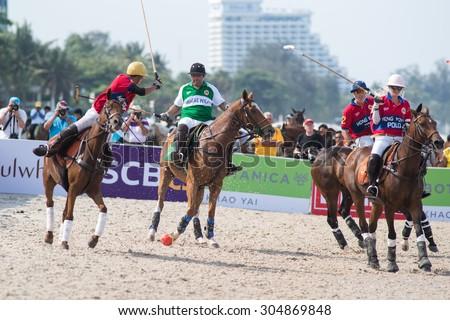 HUA HIN, THAILAND - APRIL 19: Hong Kong Polo Team (red) plays against Macau Polo Team (white-green) during 2014 Beach Polo Asia Championship on April 19 2014 in Hua Hin, Thailand.