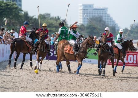 HUA HIN, THAILAND - APRIL 19: Hong Kong Polo Team (red) plays against Macau Polo Team (white-green) during 2014 Beach Polo Asia Championship on April 19, 2014 in Hua Hin, Thailand.