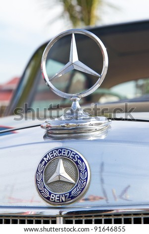 HUA HIN, THAILAND - DEC 16: Mercedes-Benz logo Vintage cars display in Hua Hin Vintage Cars Parade Festival 2011 at Hua Hin floating market on December 16, 2011 in Hua Hin, Thailand.