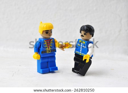 Hua Hin, Thailand - March 23 2015: Lego mini characters  on white. Lego is a popular line of construction toys manufactured by the Lego Group.