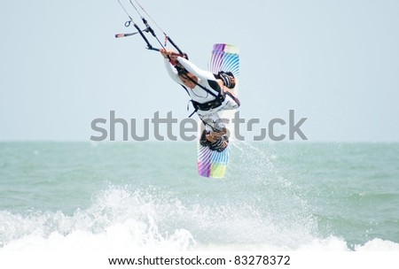 HUA HIN THAILAND - MARCH 20: PKRA Freestyle rider Bruna Kajiya of Brazil practices during the 2010 Hua Hin Kiteboard World Cup on March 20, 2010 at Hua Hin Beach in Hua Hin, Thailand