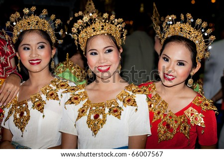 stock photo : HUA HIN, THAILAND - NOVEMBER 21: Dancers in colorful costume. Thai people float on water a small rafts (Krathong) to celebrate the Loy Krathong festival. November 21, 2010 in Hua Hin, Thailand.