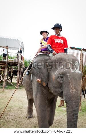 HUA HIN, THAILAND -SEPTEMBER 8: Sara Story from Sara Story Design Team in elephant polo games the 2011 King 's Cup Elephant Polo match on September 8, 2011 at Suriyothai Camp in Hua Hin, Thailand.