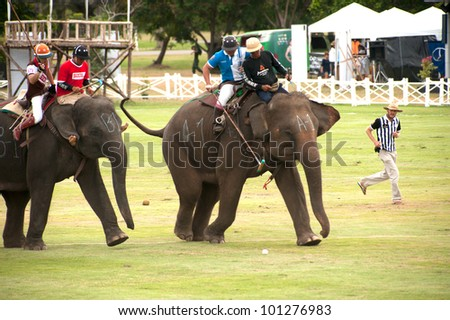 HUA HIN, THAILAND -SEPTEMBER 8: Unidentified polo players play in elephant polo games during the 2011 King 's Cup Elephant Polo match on September 8, 2011 at Suriyothai Camp in Hua Hin, Thailand.
