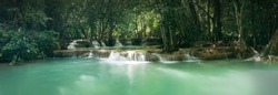 Huai Mae Khamin Waterfall in tropical rainforest with rock and turquoise blue pond has 7 tiers, Seven leveled falls are one of most beautiful waterfalls in Thailand. Khuean Srinagarindra National Park