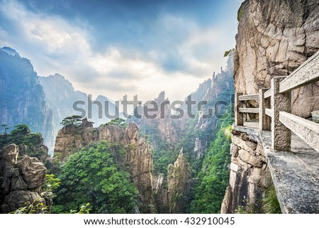 Huangshan (Yellow Mountains). Tourist steps built on the cliffs. A mountain range in Anhui province of China. It is a UNESCO World Heritage Site, and one of China\'s major tourist destinations.
