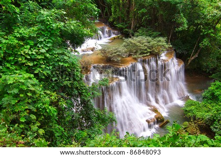 Huay mae Kamin waterfall in Thailand in deep forest - stock photo