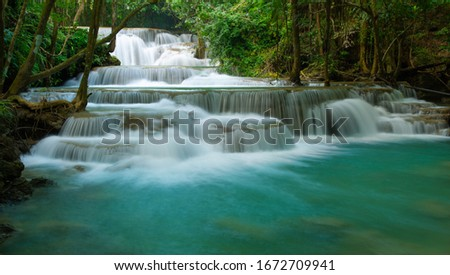 Huay Mae Khamin waterfalls in deep forest at Srinakarin National Park ,Kanchanaburi ,A beautiful stream water famous rainforest waterfall in Thailand stock photo