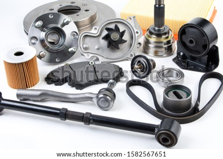 Hub, pump, brake pads, filter, timing belt, rollers, cv joints, thermostat for cars isolated on white background. New car parts .Auto parts background.