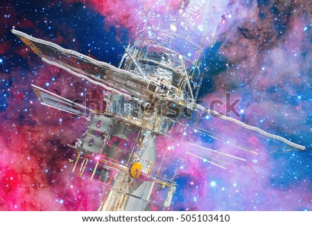 Hubble Space Telescope and nebula. Double exposure. Elements of this image furnished by NASA.