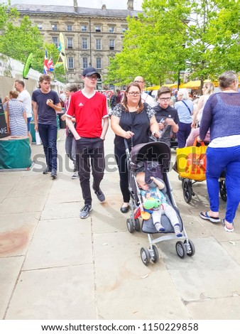 HUDDERSFIELD, UK - AUGUST 1, 2018: Unknown people at the Huddersfield Food and Drink Festival in the centre of Huddersfield, West Yorkshire, UK #1150229858