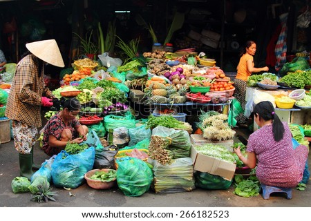 HUE, VIETNAM - MARCH 14, 2015: Vietnamese people buying and selling vegetables at Dong Ba market in Hue, Vietnam.