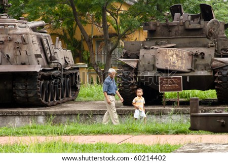 HUE, VIETNAM -SEP 2: Unidentified vietnamese grandfather brings his little nephew to visit one of the war remnants museums in Hue, on Vietnam's national day, September 2, 2010