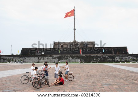 HUE, VIETNAM - SEPT 2: Unidentified group of vietnamese boys lingering in front of the Flag Tower overlooking Ngo Mon Square in Hue, on Vietnam's national day, Sept 2, 2010